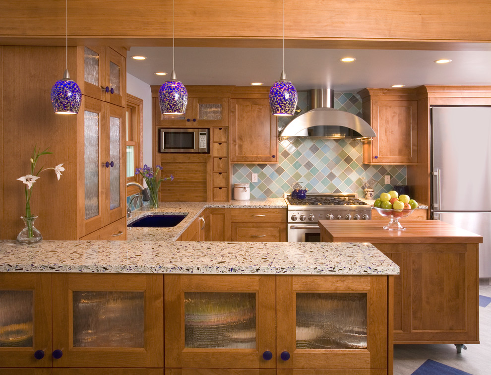 Example of a classic kitchen design in Seattle with stainless steel appliances