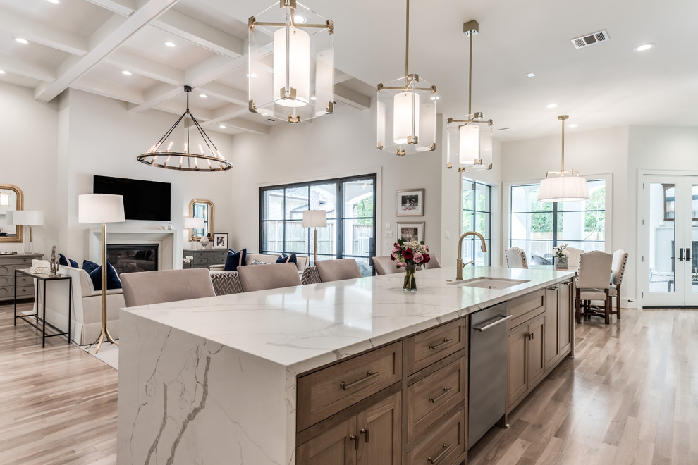 Huge transitional light wood floor and beige floor open concept kitchen photo in Houston with an undermount sink, shaker cabinets, quartz countertops, stainless steel appliances, an island, white countertops and medium tone wood cabinets