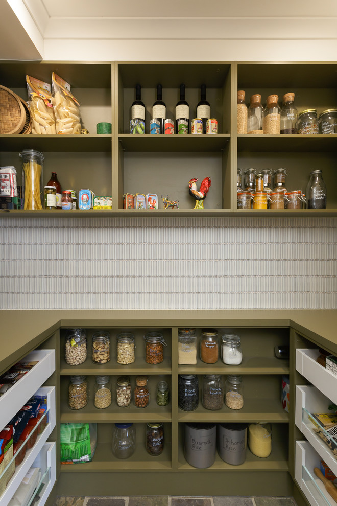 Example of a large trendy u-shaped kitchen pantry design in Melbourne with green cabinets, solid surface countertops, white backsplash, open cabinets, matchstick tile backsplash and green countertops