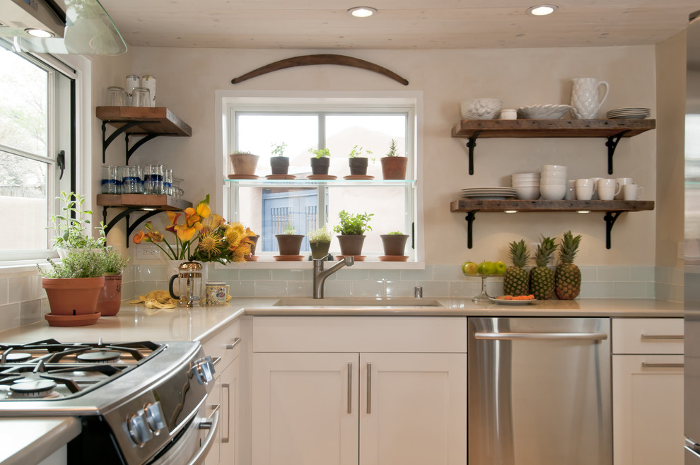 Inspiration for a mid-sized timeless l-shaped kitchen remodel in Albuquerque with stainless steel appliances