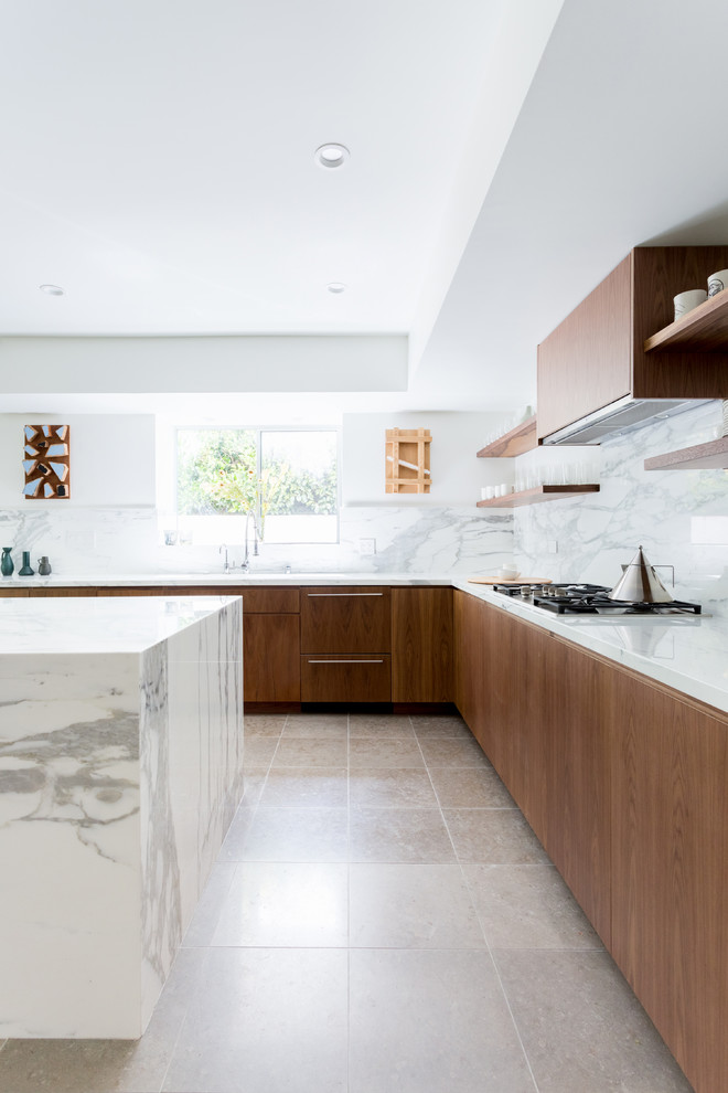 Example of a large trendy l-shaped ceramic tile and gray floor kitchen design in Los Angeles with an island, flat-panel cabinets, marble backsplash, an undermount sink, brown cabinets, marble countertops, white backsplash, paneled appliances and gray countertops