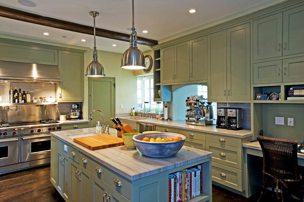 Mid-sized elegant l-shaped enclosed kitchen photo in Los Angeles with stainless steel appliances, quartzite countertops, a farmhouse sink, shaker cabinets, green cabinets, stone slab backsplash and an island