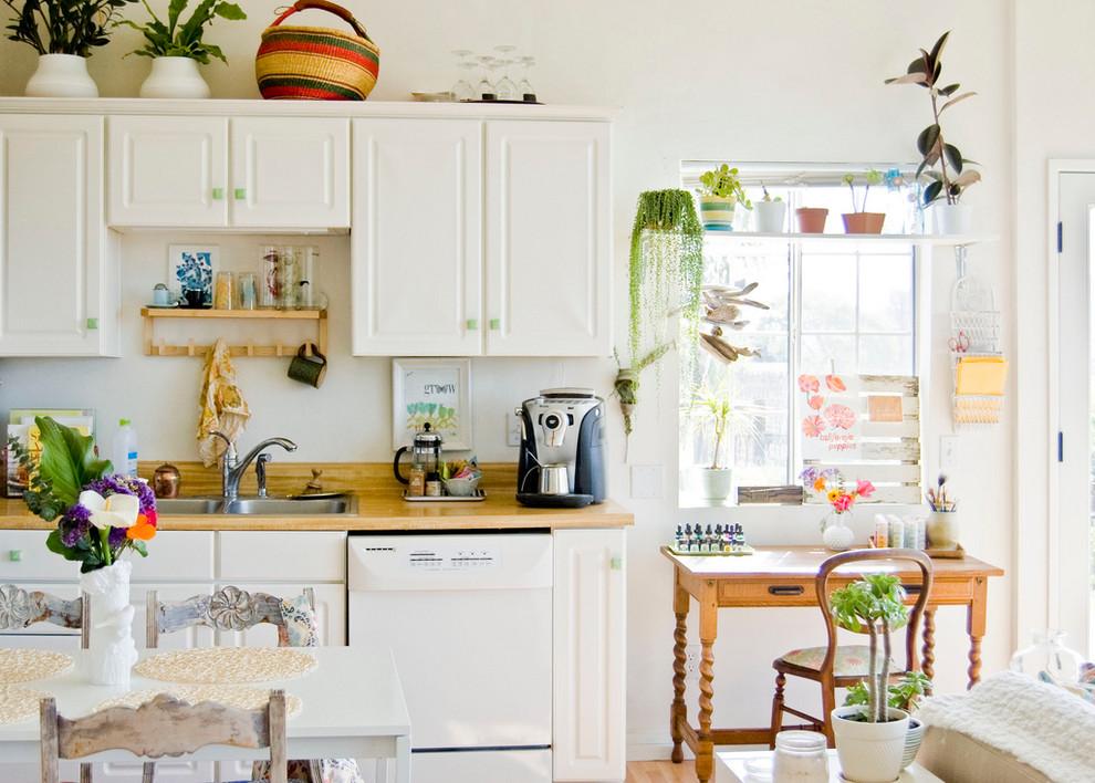 Kitchen - farmhouse kitchen idea in Santa Barbara with white appliances