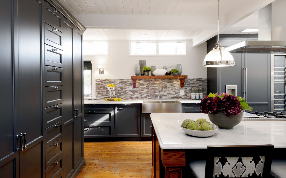 Inspiration for a transitional kitchen remodel in Other with a farmhouse sink, recessed-panel cabinets, multicolored backsplash, matchstick tile backsplash and paneled appliances