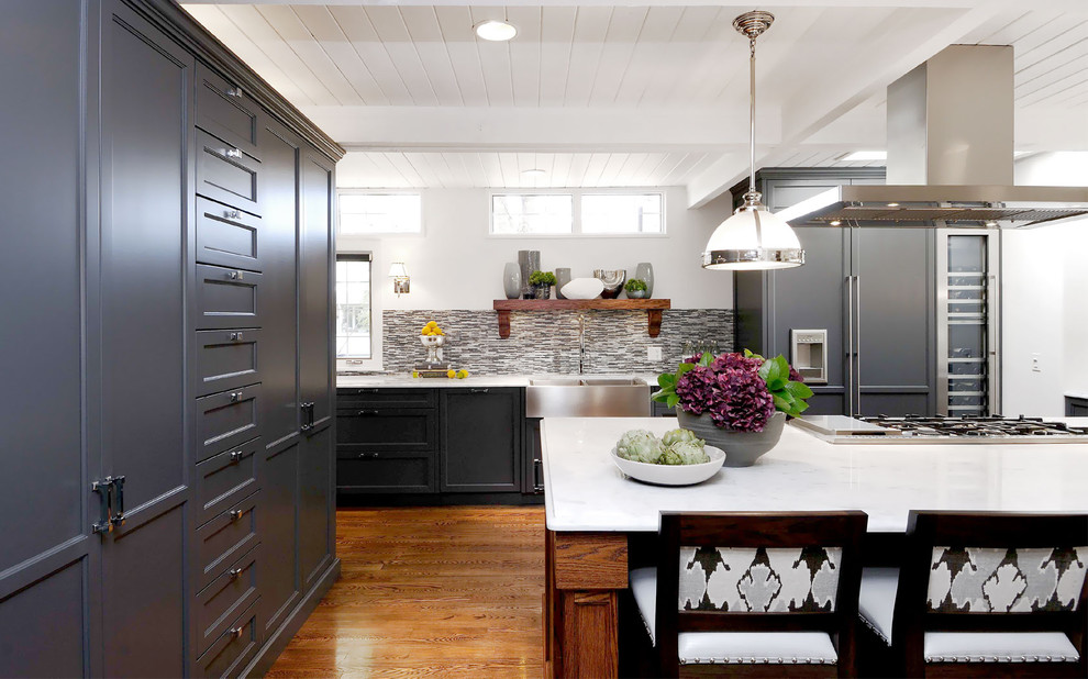 Example of a transitional kitchen design in Other with a farmhouse sink, recessed-panel cabinets, multicolored backsplash, matchstick tile backsplash and paneled appliances