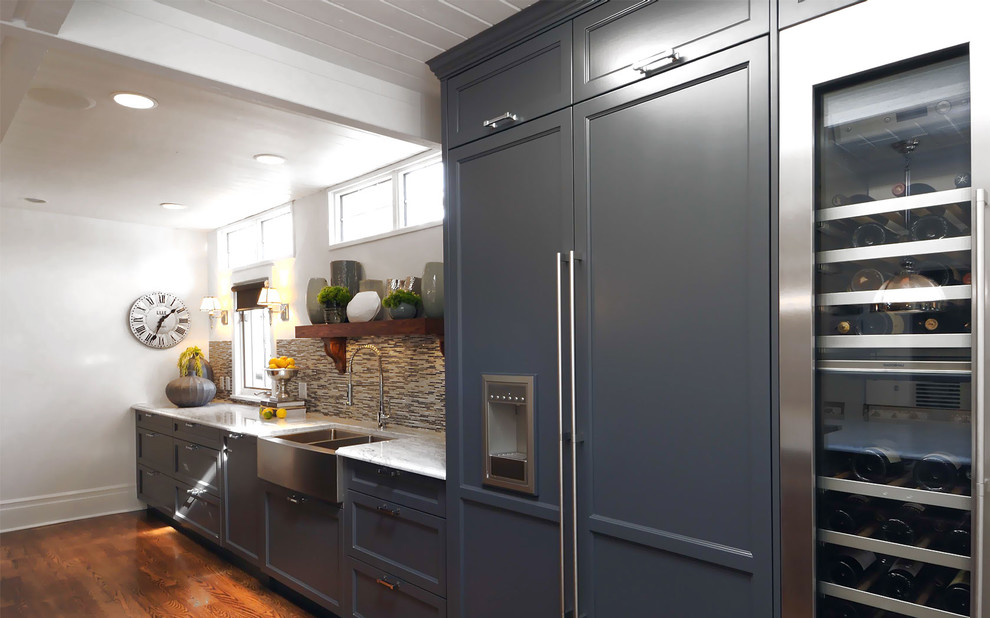 Example of a transitional kitchen design in Other with a farmhouse sink, recessed-panel cabinets, brown backsplash, matchstick tile backsplash, paneled appliances and blue cabinets