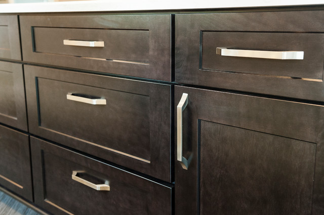 Satin nickel cabinet pulls on Onyx stained shaker cabinets