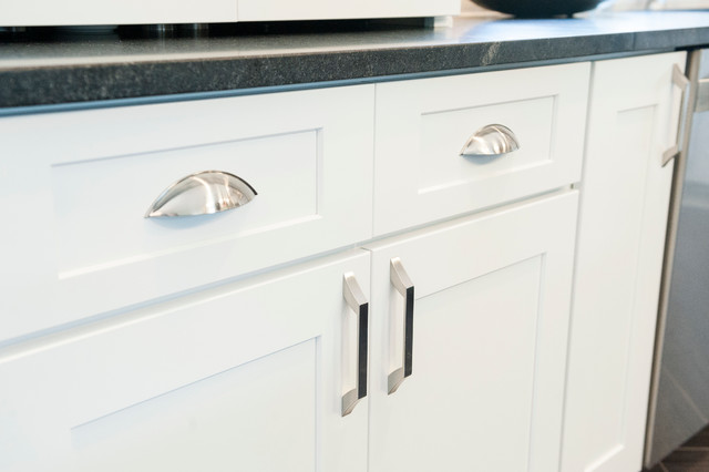 Satin nickel cabinet pulls on white shaker cabinets