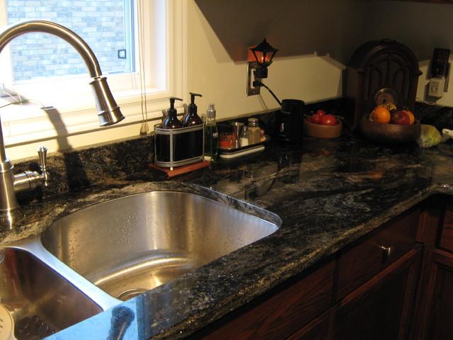 Saturnia Granite Kitchen Counters eclectic-kitchen