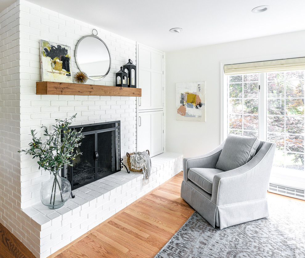 Eat-in kitchen - large transitional l-shaped light wood floor eat-in kitchen idea in Philadelphia with a farmhouse sink, flat-panel cabinets, white cabinets, soapstone countertops, white backsplash, ceramic backsplash, paneled appliances, an island and gray countertops