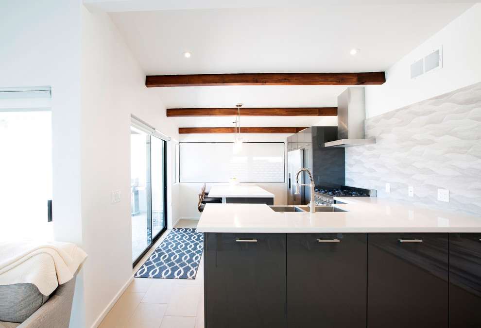 Inspiration for a mid-sized mid-century modern l-shaped porcelain tile open concept kitchen remodel in Phoenix with a farmhouse sink, flat-panel cabinets, gray cabinets, quartz countertops, gray backsplash, porcelain backsplash, stainless steel appliances and an island