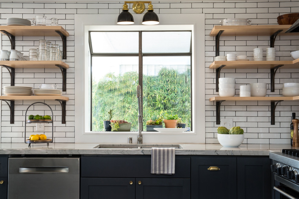Small eclectic l-shaped dark wood floor and brown floor open concept kitchen photo in Las Vegas with an undermount sink, shaker cabinets, gray cabinets, quartzite countertops, white backsplash, subway tile backsplash, stainless steel appliances and an island