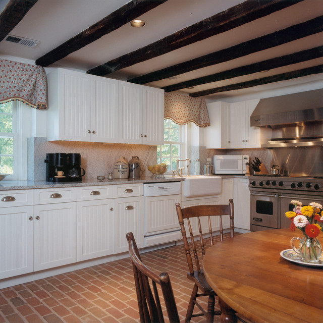 Marvelous Beadboard Cabinets Part - 9: Example Of A Classic Brick Floor Kitchen Design In Baltimore With A  Farmhouse Sink