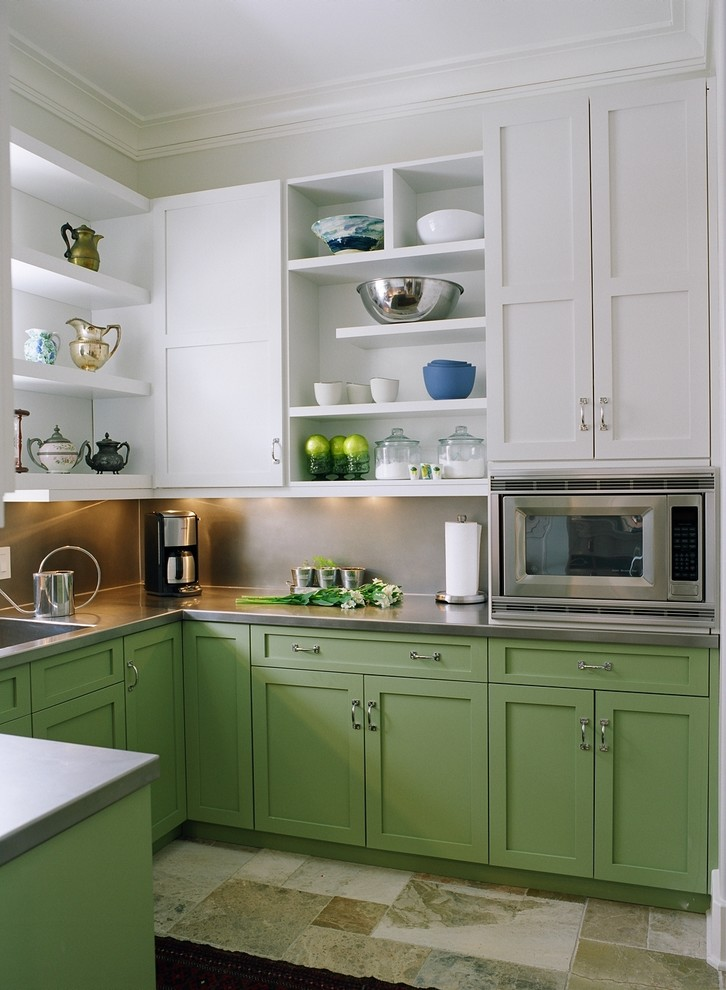 Inspiration for a timeless u-shaped multicolored floor enclosed kitchen remodel in Nashville with stainless steel appliances, green cabinets, stainless steel countertops, an integrated sink, shaker cabinets, metallic backsplash and no island