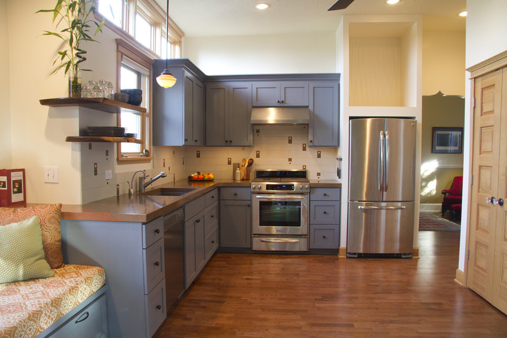 Example of an eclectic l-shaped kitchen design in Portland with stainless steel appliances, a single-bowl sink and blue cabinets
