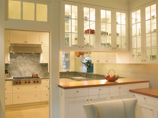 Example Of A Clic Enclosed Kitchen Design In San Francisco With Gl Front Cabinets