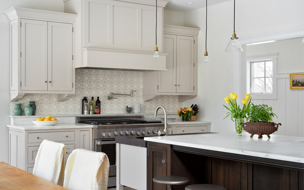 Inspiration for a transitional medium tone wood floor eat-in kitchen remodel in Atlanta with shaker cabinets, gray cabinets, stainless steel appliances and an island