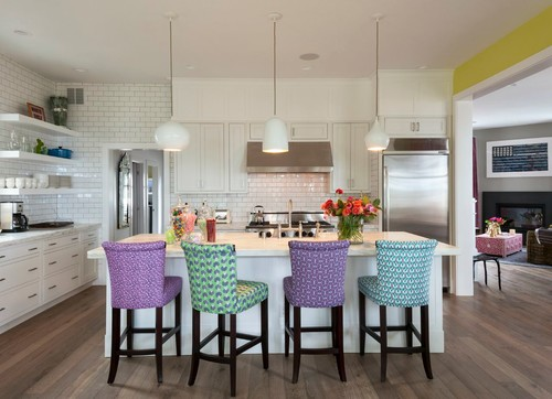 Clean and modern kitchen design featuring four multi-colored stools with different patterns for a mix-and-match look