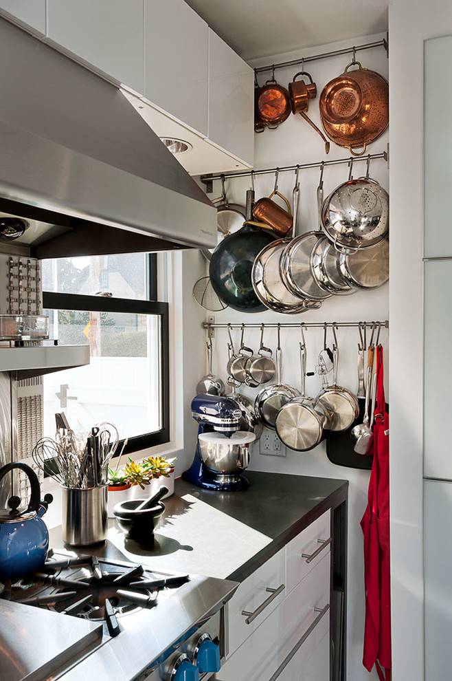 Inspiration for a contemporary kitchen remodel in Boston with flat-panel cabinets, white cabinets and stainless steel appliances