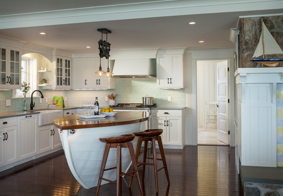 Beach style l-shaped dark wood floor kitchen photo in Providence with a farmhouse sink, recessed-panel cabinets, white cabinets, blue backsplash and glass tile backsplash