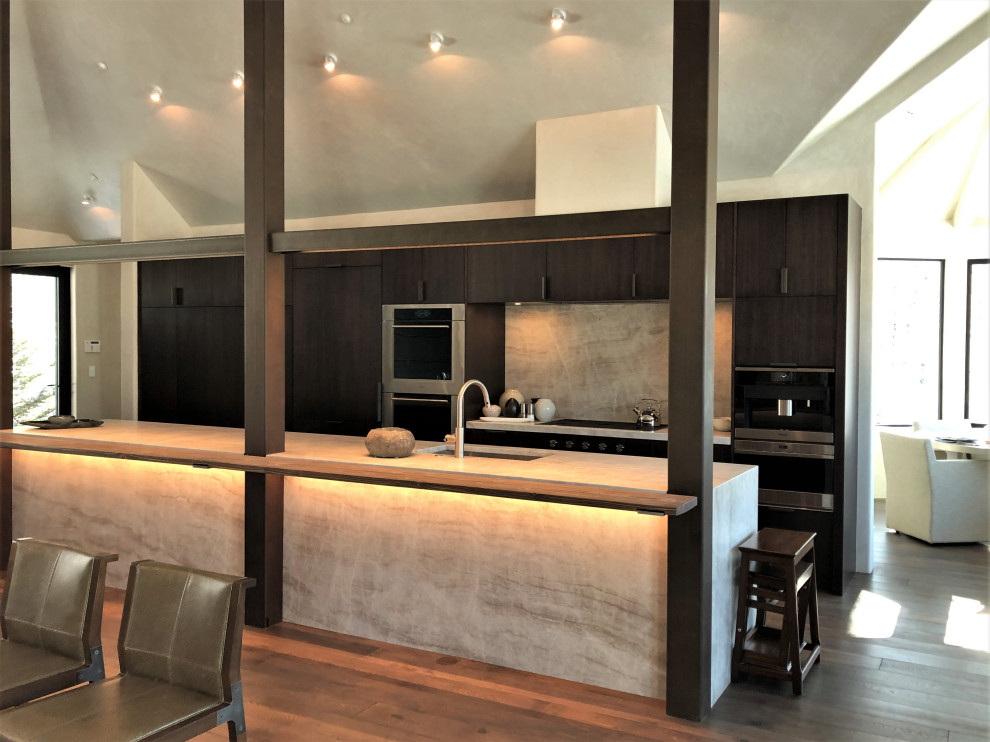 Open concept kitchen - large contemporary galley medium tone wood floor, brown floor and vaulted ceiling open concept kitchen idea in Other with an undermount sink, flat-panel cabinets, dark wood cabinets, multicolored backsplash, colored appliances, an island and multicolored countertops