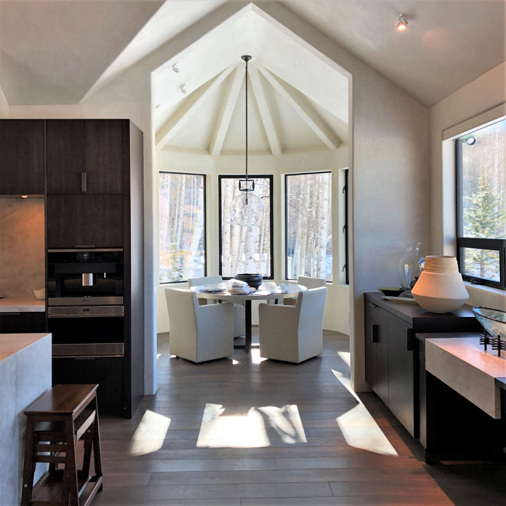 Large trendy galley medium tone wood floor, brown floor and vaulted ceiling open concept kitchen photo in Other with an undermount sink, flat-panel cabinets, dark wood cabinets, multicolored backsplash, colored appliances, an island and multicolored countertops