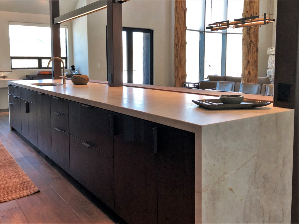 Example of a large trendy galley medium tone wood floor, brown floor and vaulted ceiling open concept kitchen design in Other with an undermount sink, flat-panel cabinets, dark wood cabinets, colored appliances, an island and multicolored countertops