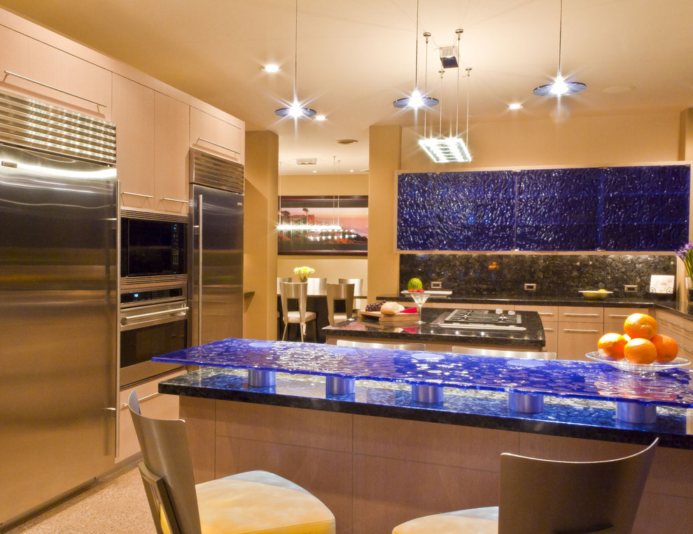 Large trendy concrete floor and beige floor eat-in kitchen photo in Phoenix with glass-front cabinets, glass countertops, black backsplash, glass tile backsplash, stainless steel appliances, two islands and blue countertops