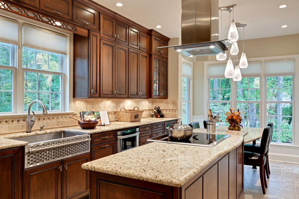 Elegant kitchen photo in Atlanta with a farmhouse sink and granite countertops