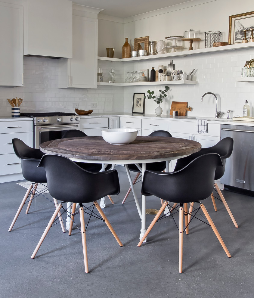 Small danish l-shaped concrete floor eat-in kitchen photo in Atlanta with an undermount sink, flat-panel cabinets, white cabinets, marble countertops, white backsplash, ceramic backsplash, stainless steel appliances and no island