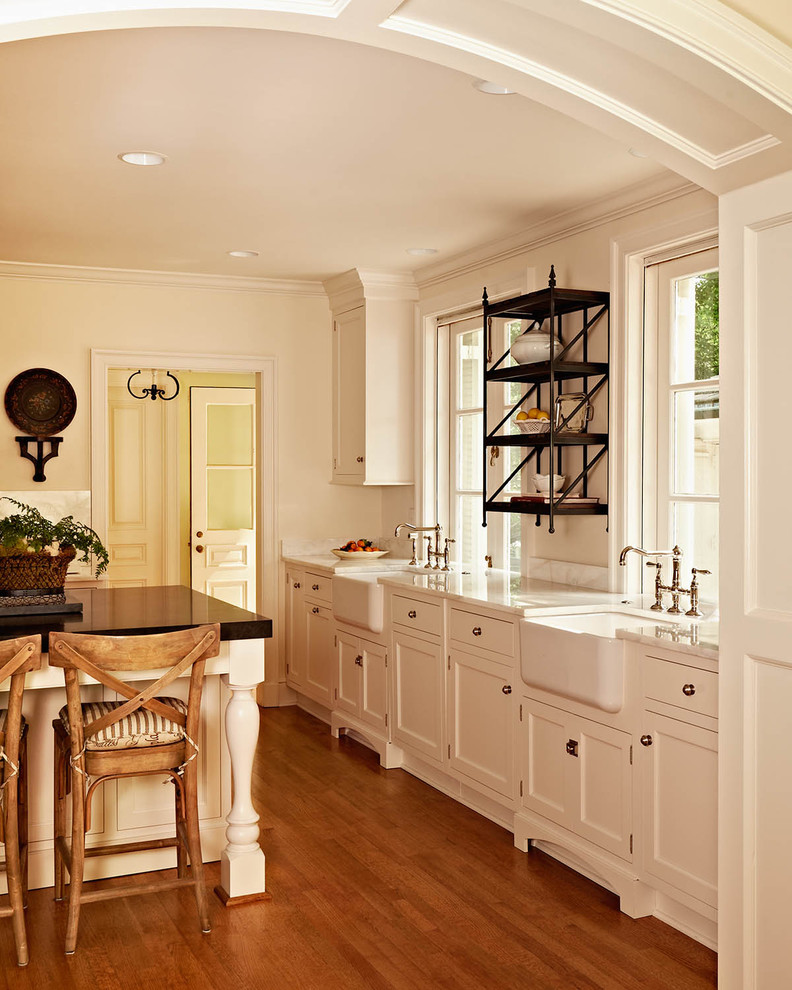 Example of a classic kitchen design in Charlotte with a farmhouse sink and marble countertops
