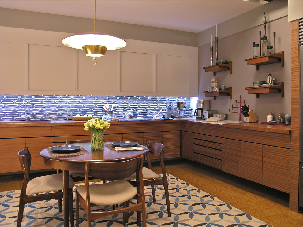 Example of a trendy l-shaped enclosed kitchen design in New York with an undermount sink, flat-panel cabinets, white cabinets, wood countertops, metallic backsplash, ceramic backsplash and stainless steel appliances