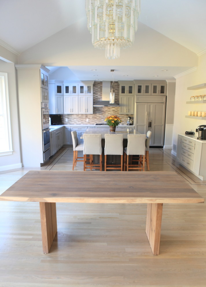Inspiration for a huge craftsman light wood floor eat-in kitchen remodel in Providence with a single-bowl sink, shaker cabinets, gray cabinets, quartzite countertops, gray backsplash, stone tile backsplash and stainless steel appliances