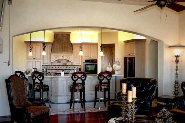 Eat-in kitchen - rustic brick floor eat-in kitchen idea in Austin with raised-panel cabinets, light wood cabinets, granite countertops, beige backsplash, stone tile backsplash and an island