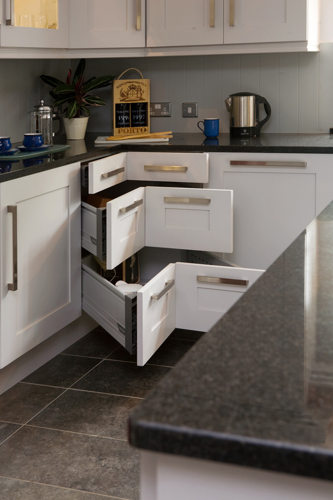 Kitchen - transitional kitchen idea in Other with shaker cabinets, white cabinets and black countertops