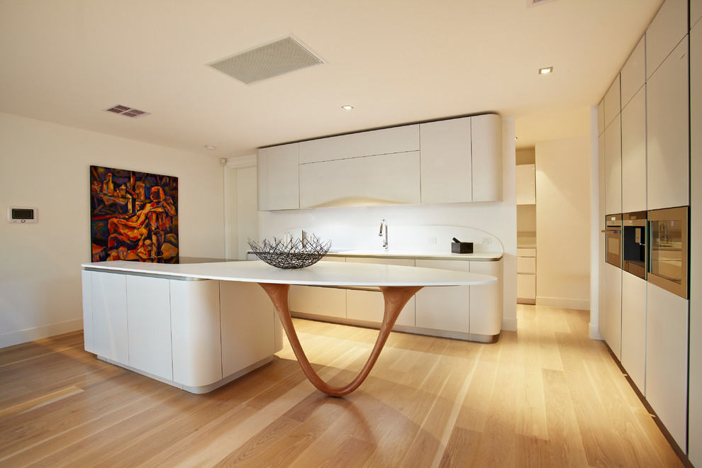 Trendy u-shaped open concept kitchen photo in Melbourne with flat-panel cabinets, white cabinets, solid surface countertops, white backsplash and stone slab backsplash