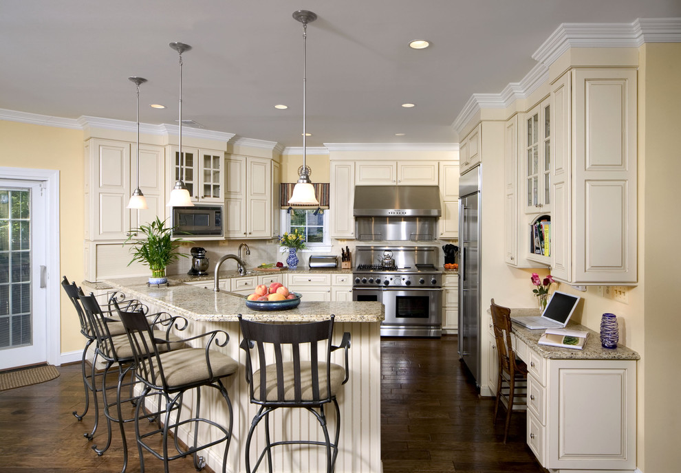 Elegant kitchen photo in DC Metro with stainless steel appliances, granite countertops, raised-panel cabinets and beige cabinets