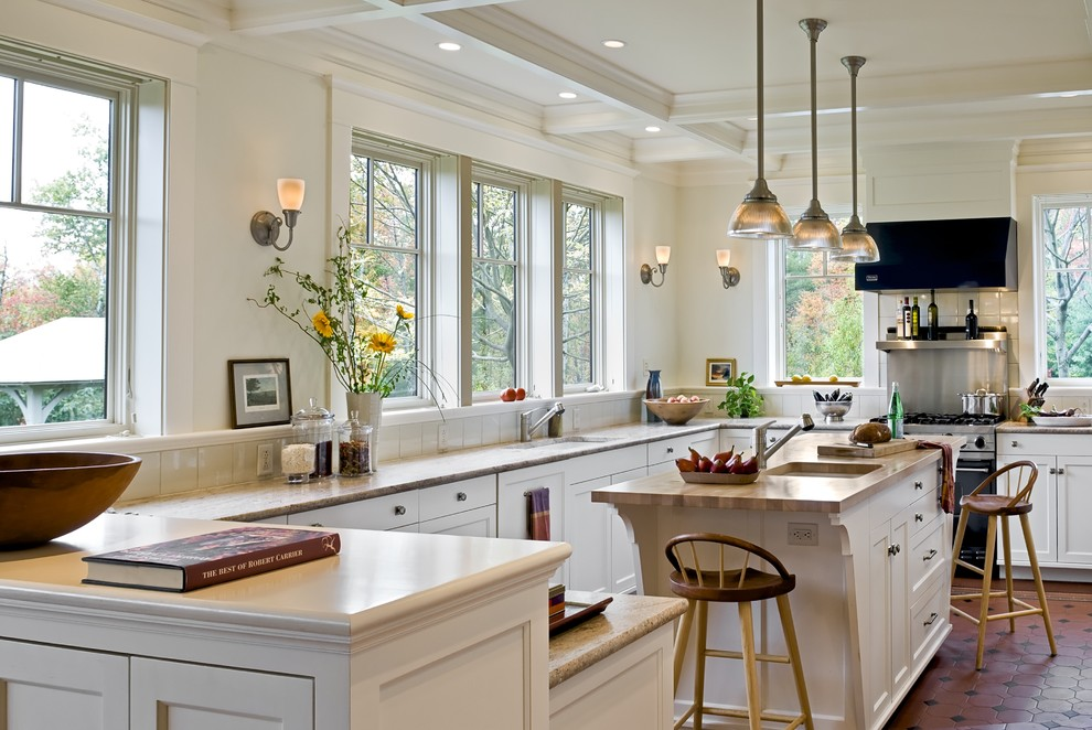 Inspiration for a victorian kitchen remodel in Burlington with wood countertops, recessed-panel cabinets, white cabinets and stainless steel appliances