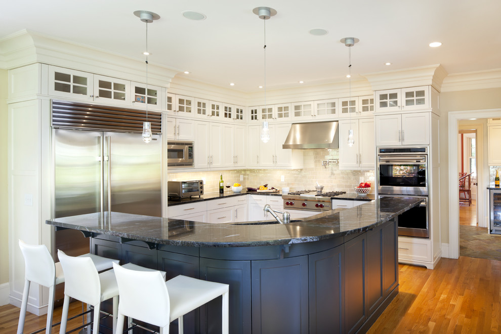 Ornate kitchen photo in Boston with stainless steel appliances, glass-front cabinets and white cabinets