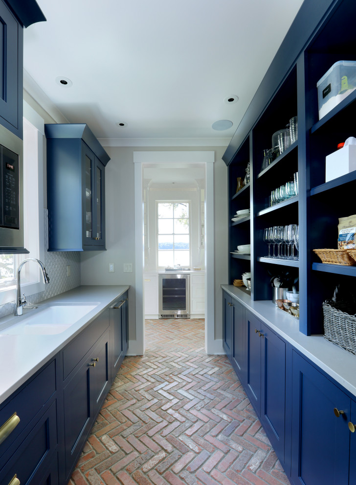 Kitchen pantry - mid-sized transitional galley brick floor and red floor kitchen pantry idea in Grand Rapids with recessed-panel cabinets, blue cabinets, granite countertops, white backsplash, shiplap backsplash, stainless steel appliances, white countertops and no island