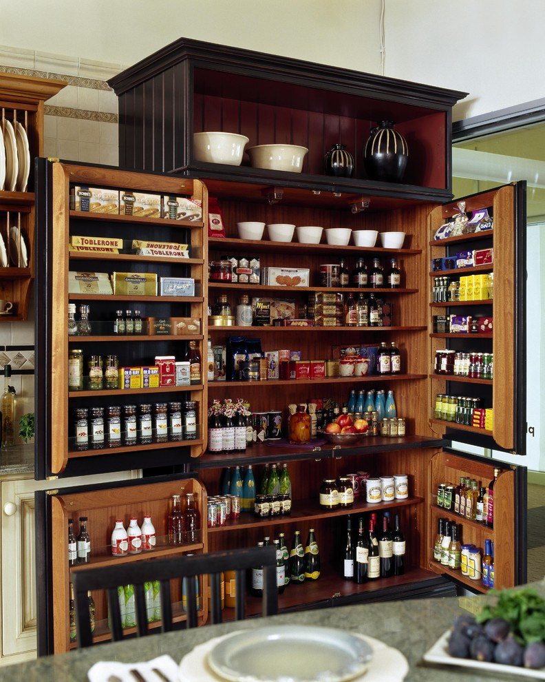 Inspiration for a timeless kitchen pantry remodel in Boston with recessed-panel cabinets