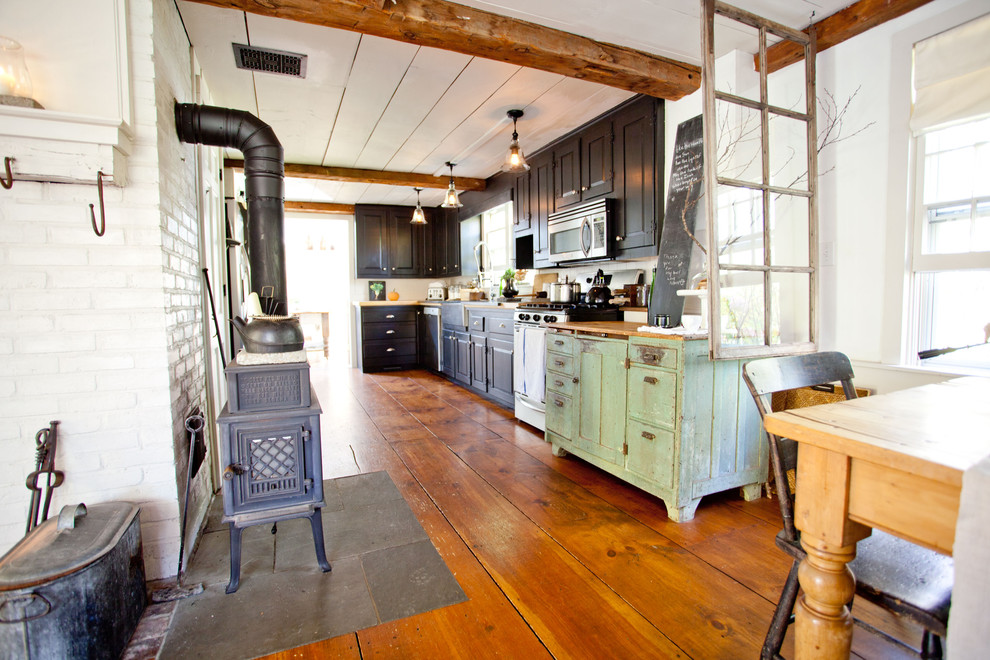 Inspiration for a farmhouse kitchen remodel in Boston with black cabinets