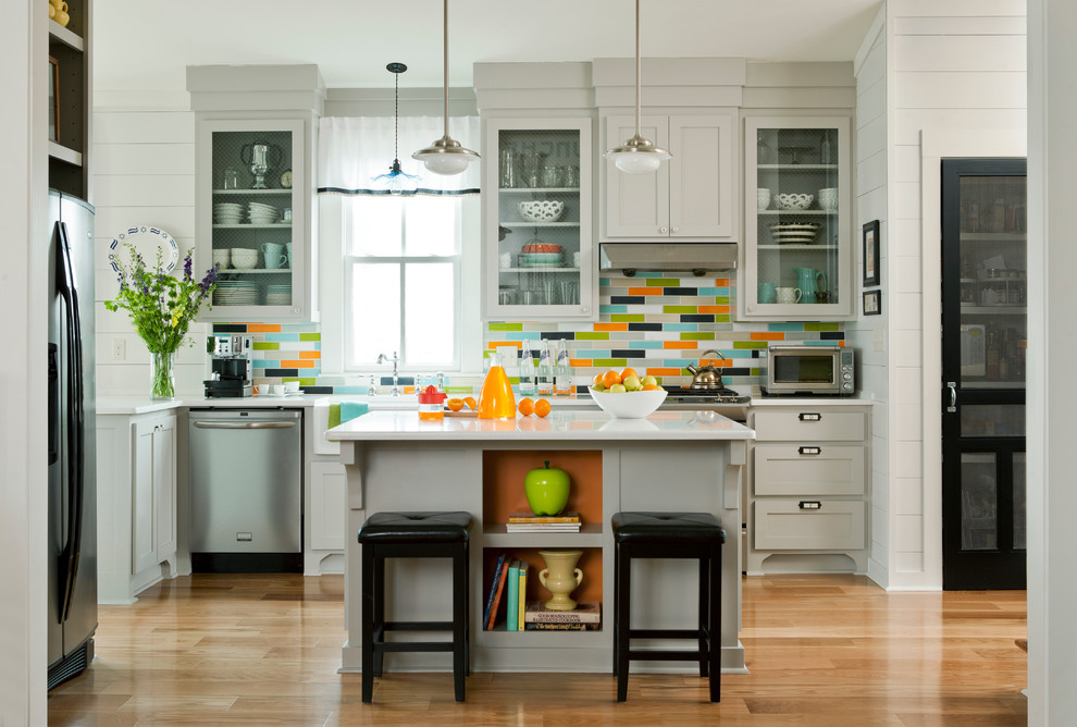 Example of a transitional kitchen design in Little Rock with a farmhouse sink, glass-front cabinets, gray cabinets, quartz countertops, multicolored backsplash and ceramic backsplash