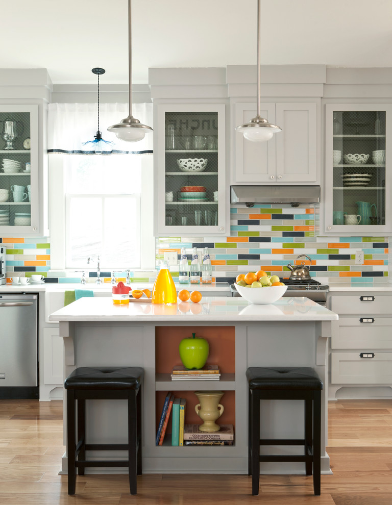 Transitional kitchen photo in Little Rock with gray cabinets, multicolored backsplash and glass-front cabinets