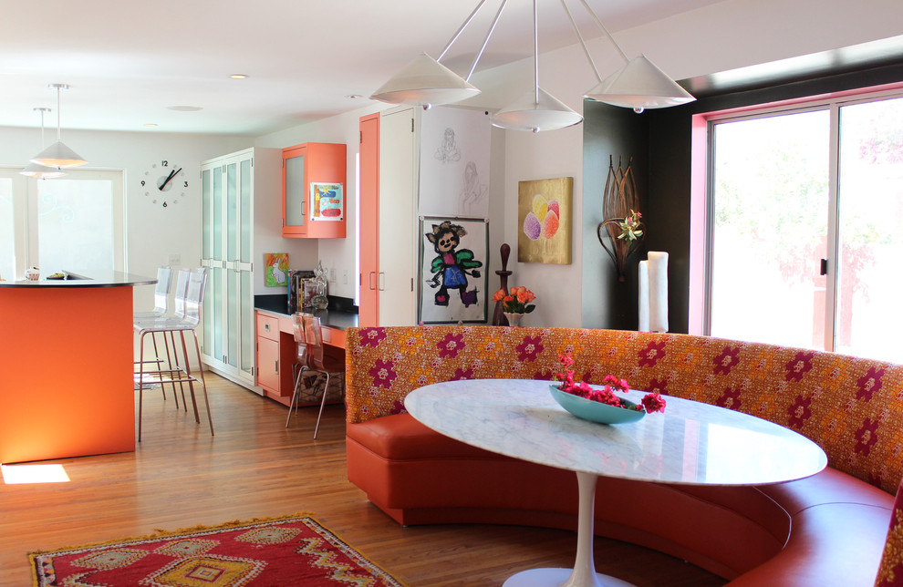 Trendy eat-in kitchen photo in Los Angeles with flat-panel cabinets and orange cabinets