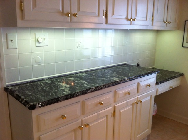 Silver Waves Granite on White Cabinets