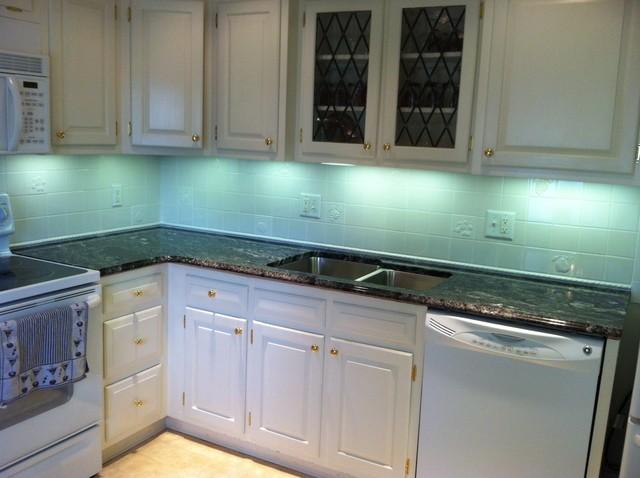White Silver Granite Countertop : Silver Waves Granite on White Cabinets contemporary-kitchen