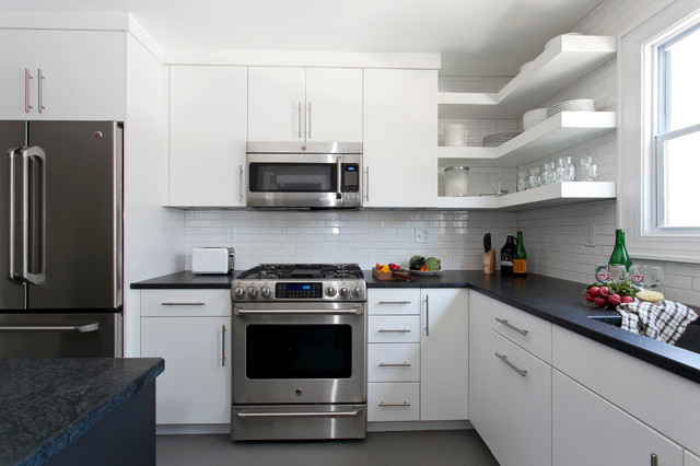 Simple clean lines in this white kitchen modern for Basic white kitchen units
