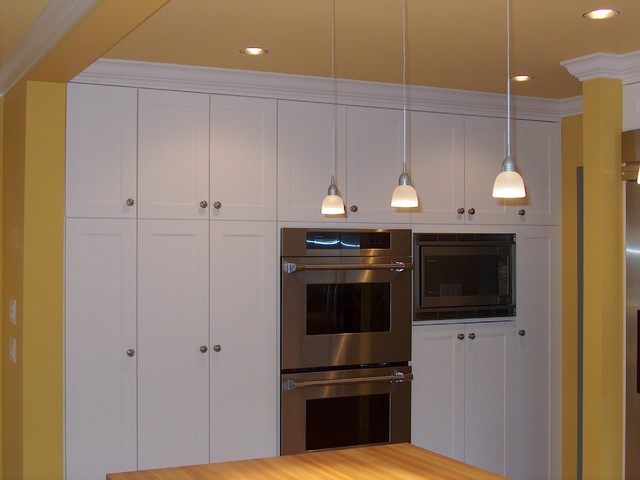 Simple white built in cabinets traditional kitchen for Built in kitchen cupboards for a small kitchen