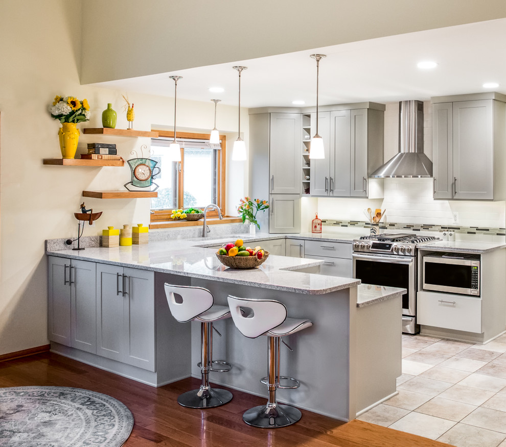 Mid-sized transitional u-shaped beige floor kitchen photo in Detroit with shaker cabinets, gray cabinets and white backsplash